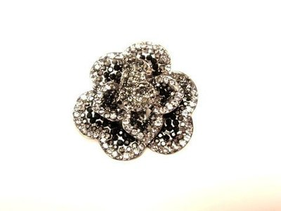 Broche acero/cristal swarovski flor  7021